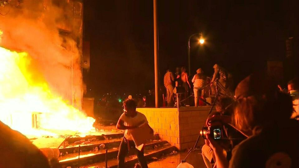 Protesters set Minneapolis police station on fire